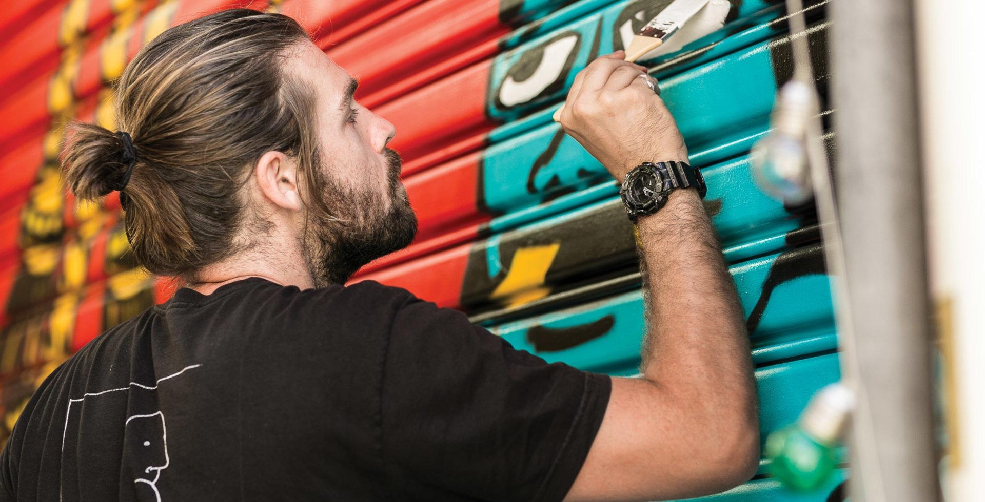 McPherson dials in the details of a mural in Melbourne, Australia. Photo: Leandro Olgiati
