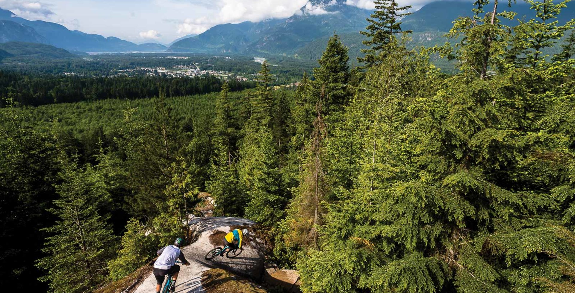 While Squamish, BC has long been known for granite slabs, its progressive land-management strategies might soon be the talk of the town. Stephen Matthews and Sid Slotegraaf drop into Dirk's Diggler with stunning views of the Howe Sound. Photo: Reuben Krabbe
