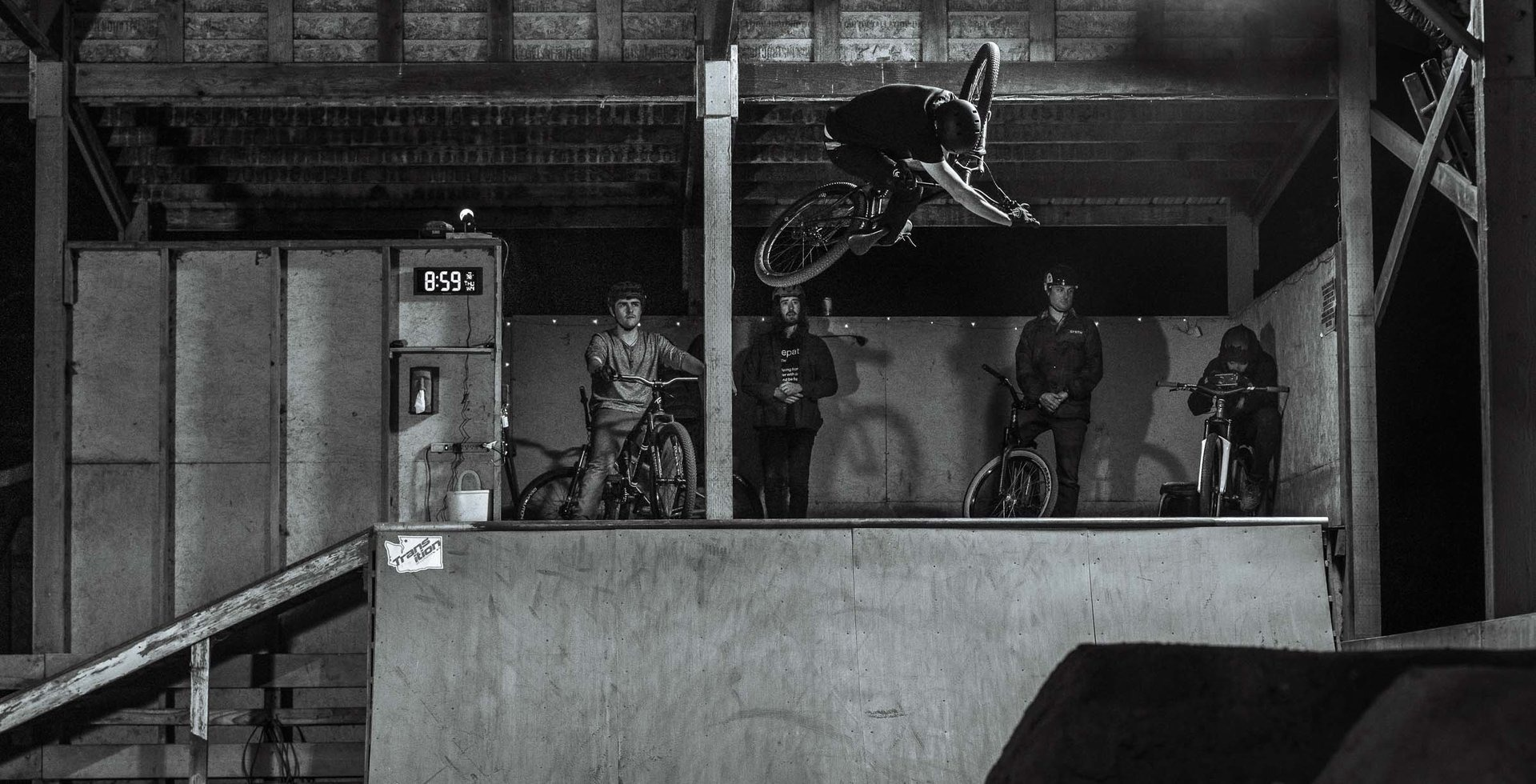 For Bellingham's hardcore bikers, the Bike Ranch is a frequent hangout during winter months. Billy Lewis blasts out of the quarter pipe as the rest of the crew watches on.