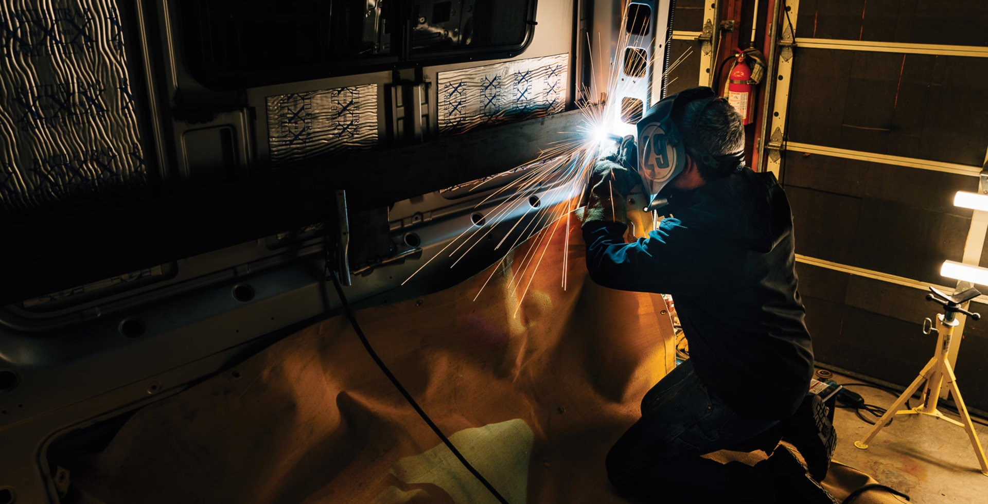 From routing and cutting to gluing and welding, the list of tools required for a full-scale buildout is not short. Tyler Earnheart puts in some late night hours on Jill and Bryn's van.